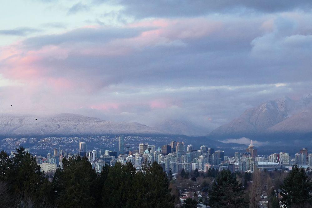 Photo in Cityscape #cityscape #mountains #snowcapped #winter #clouds #urban landscape