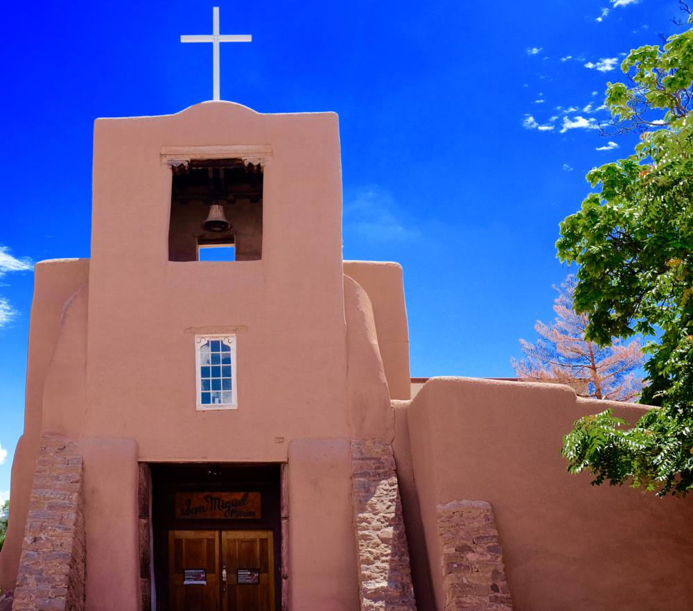 Photo in Architecture #san miguel #church #cross #bell #blue #santa fe
