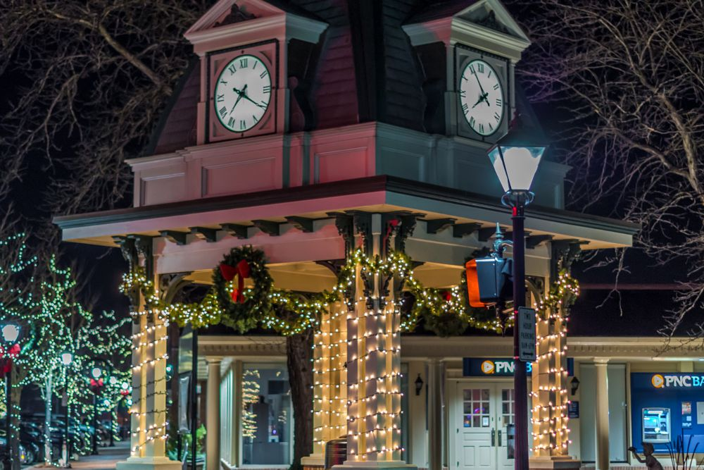 Photo in Street Photography #clock #town #night #christmas #lights #bank