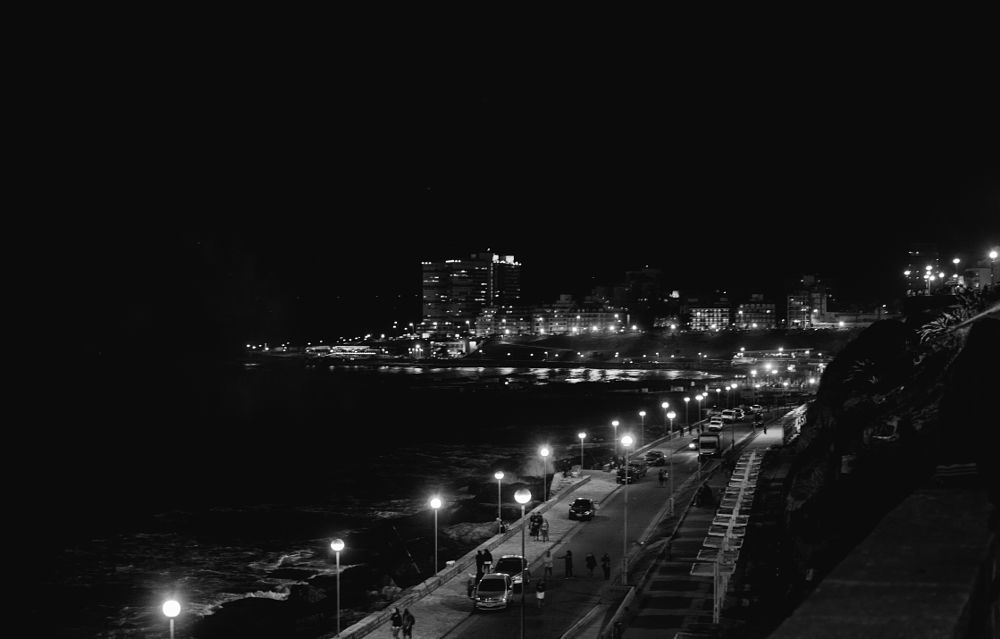 Photo in Cityscape #city #beach #nigth #lights #cars #people #black&white #sea