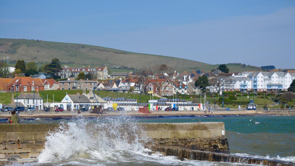 Photo in Landscape #rough #sea #stone quay #beach huts