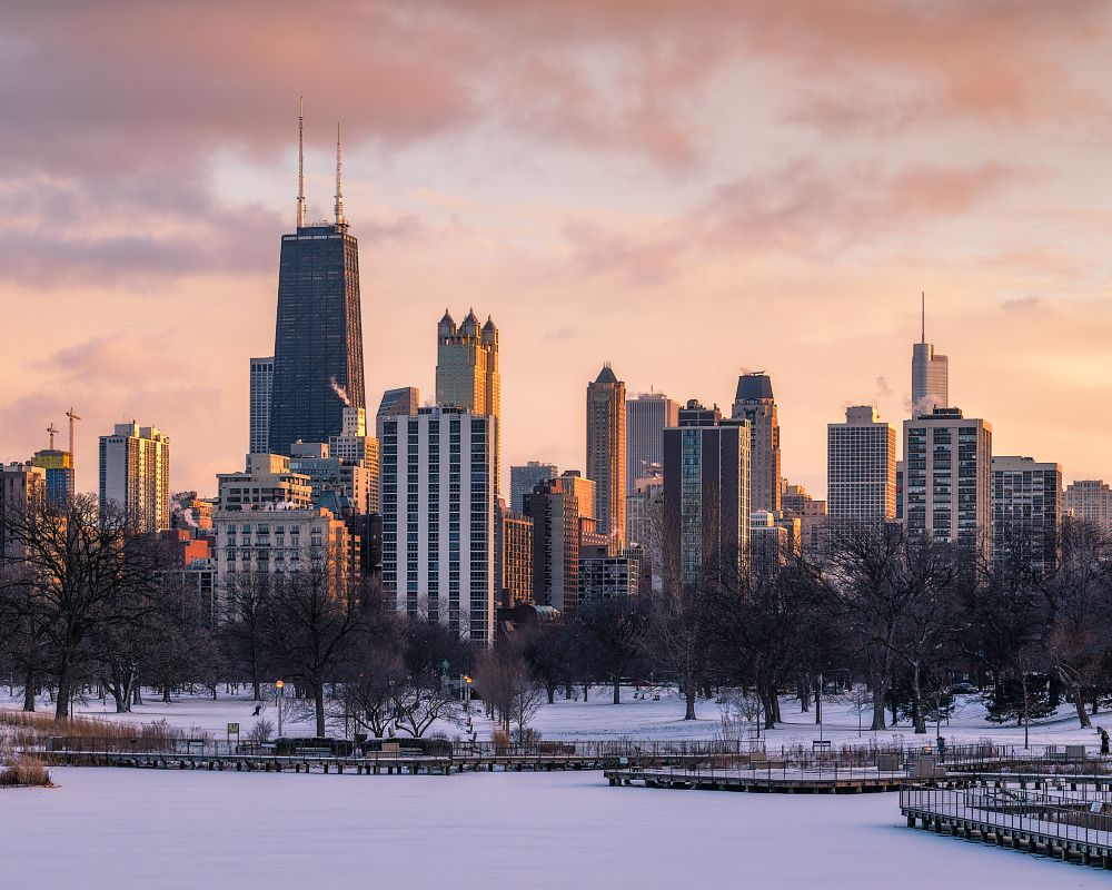 Photo in Cityscape #chicago #sunset #winter #snow #light #lincoln park #pink #yellow #serene #drama
