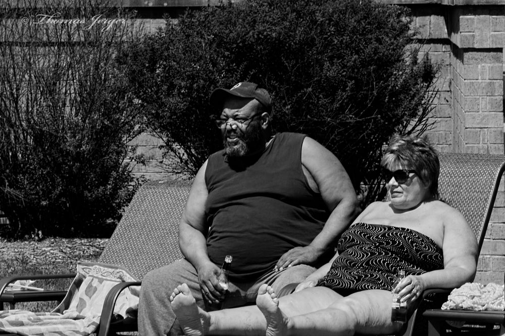Photo in Street Photography #people #couple #man #woman #pool party #summer #wisconsin #black and white #street photography