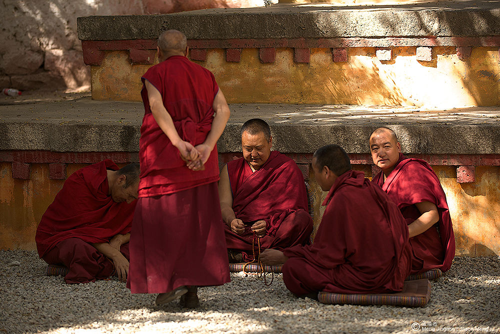 Photo in Portrait #monks #portrait #people #tibet #china #sun #wall #red