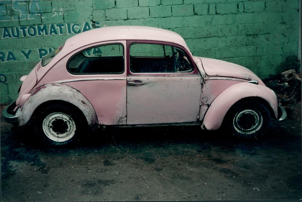 Photo in Street Photography #pink bug #old station #broken down vw