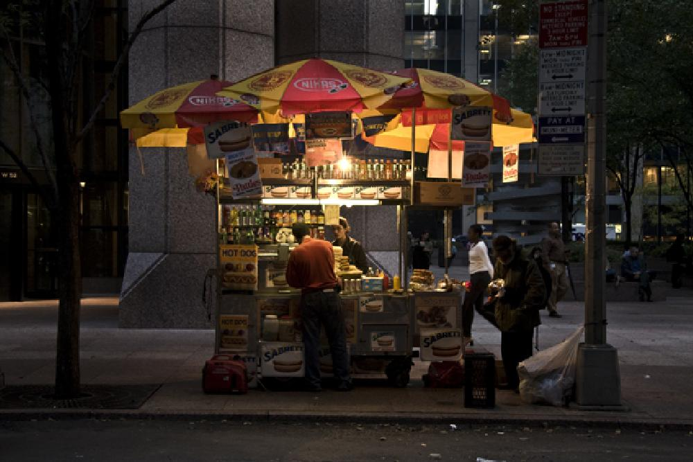 Photo in Street Photography #dog vender #late night #after dark #on a cart