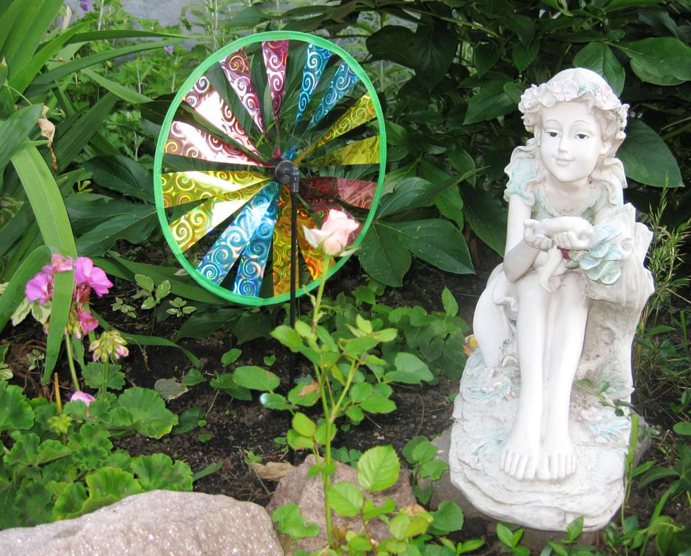 Photo in Nature #rose #fairy #garden #pin wheel #geranium #city #green foliage #in the green foliage