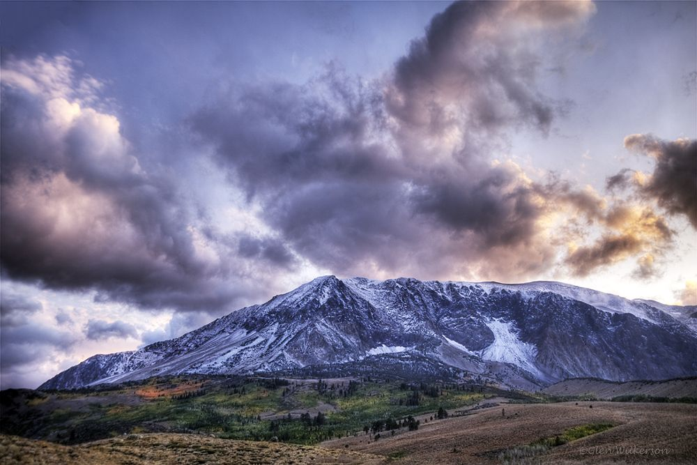 Photo in Landscape #sunset #mountains #fall color #landscape #colorful #snow #green #clouds