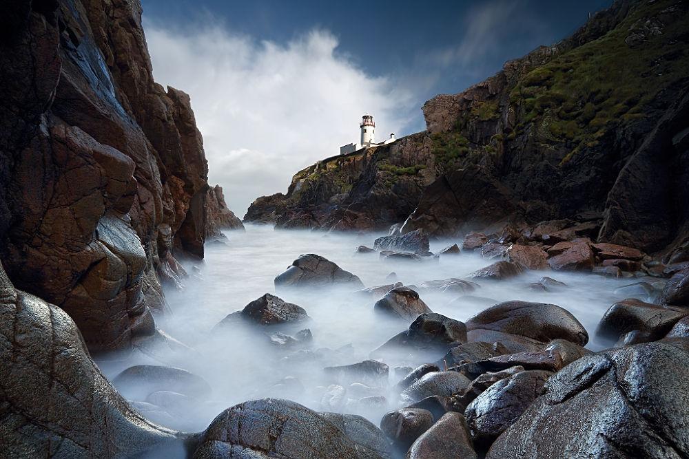 Photo in Landscape #co. donegal #ireland #fanad #stones #long exposure #lighthouse #rocks #marius kasteckas