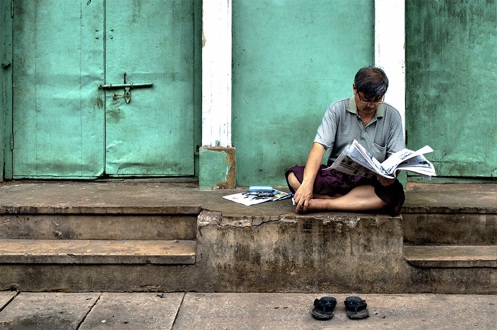 Photo in Street Photography #reading a newspaper