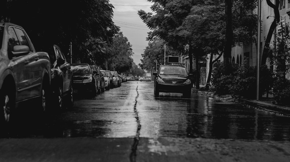 Photo in Street Photography #street #streetphotography #calle #city #cityscape #ciudad #santiago #chile #urban #cinematic #noir #noiretblanc #monotone #monochrome #blackandwhite #car #nikon #d7000 #50mm