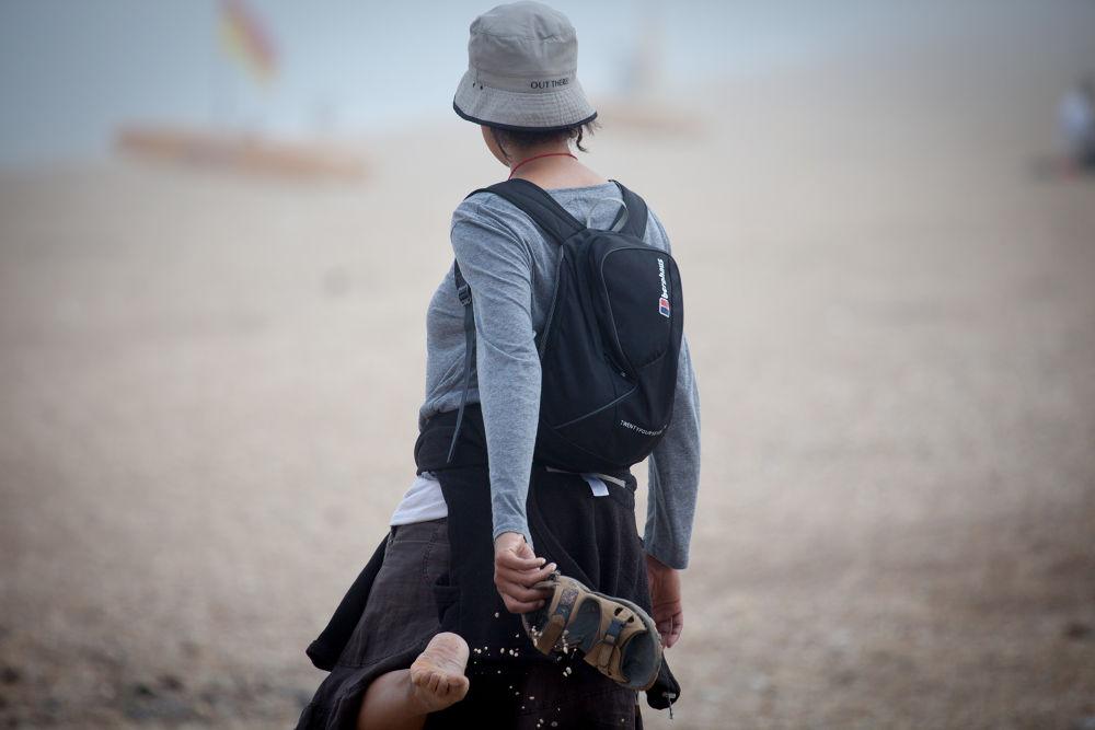 Photo in People #sandal #stone #pebble #girl #slapton sand