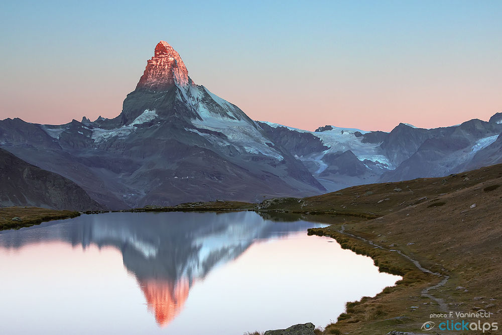 Photo in Random #alps #sunrise #matterhorn #switzerland #lake #landscape #red #sun #peak #light #outdoor #water #montagna #cervino #alpi #svizzera