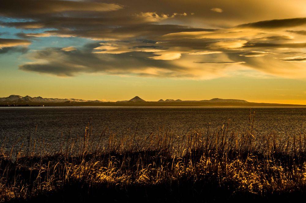 Photo in Landscape #sun #sunset #sunrise #sea #ocean #beach #grass #mountains #volcano #ridge #peninsula