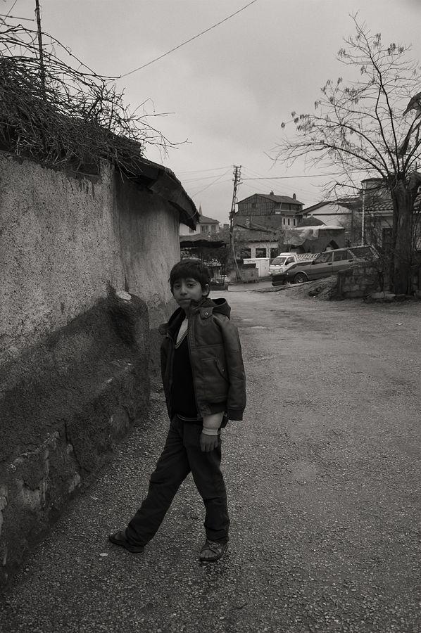 Photo in Street Photography #boy #street #streetphotography #sephia #blackandwhite #ankara #ulus #turkey