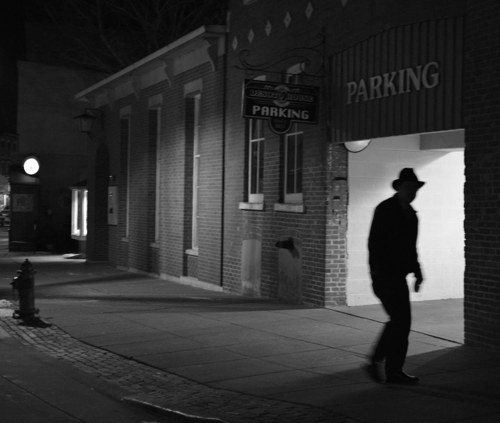 Photo in Street Photography #bw #black and white #solitary man #night photography #light and shadow #silhouette #galena #street