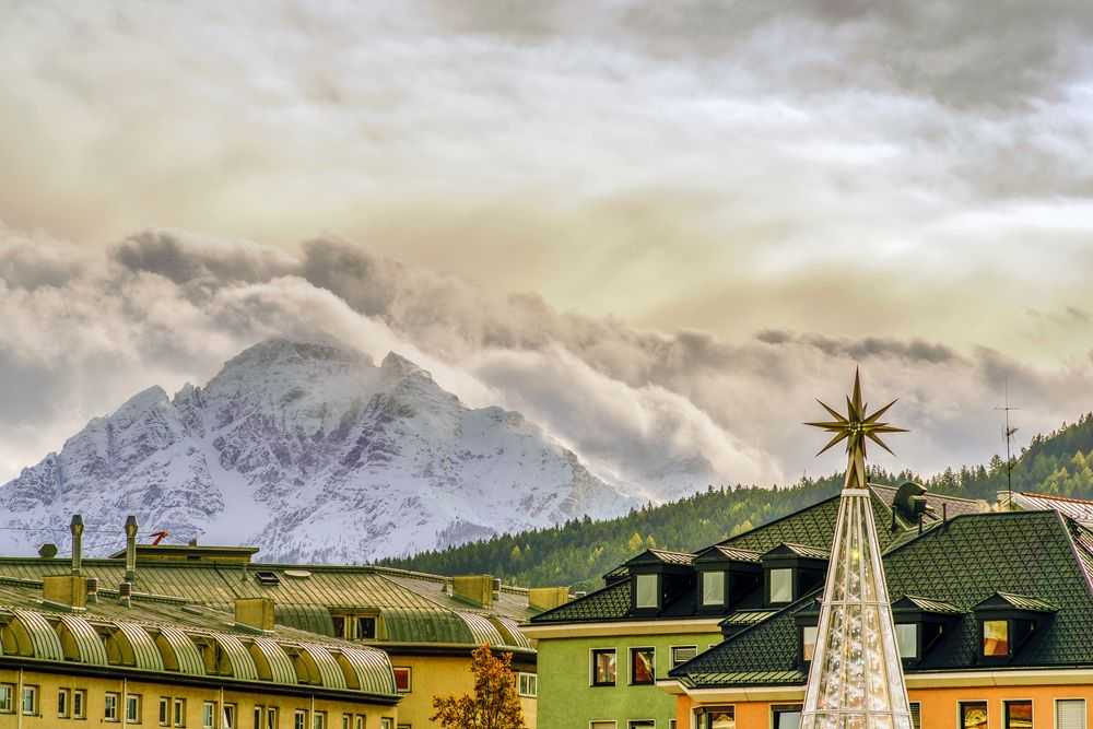 Photo in Cityscape #tree #trees #roofs #mountain #forest #alps