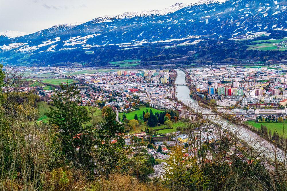 Photo in Cityscape #city #mountaing #alps #river inn #bridges