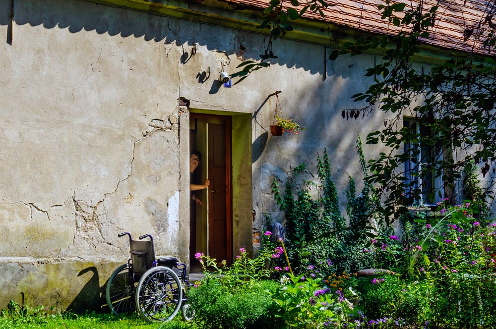 Photo in Street Photography #wheelchair #house #people #subject #emotions #colours #still life