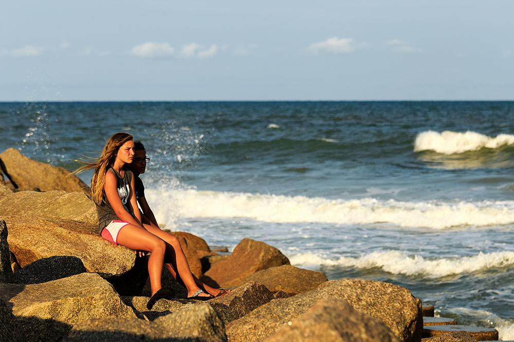 Photo in Journalism #summer #sunset #joy #beach #ocean #atlantic #girls #rocks #stones #water