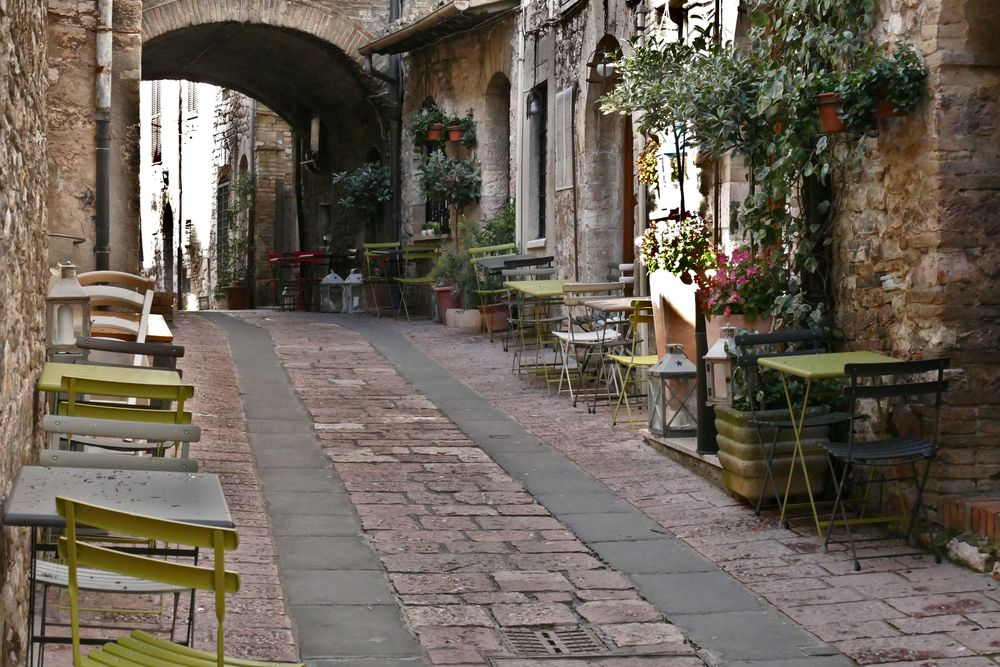 Photo in Street Photography #vicolo #assisi #café tables #perugia #umbria