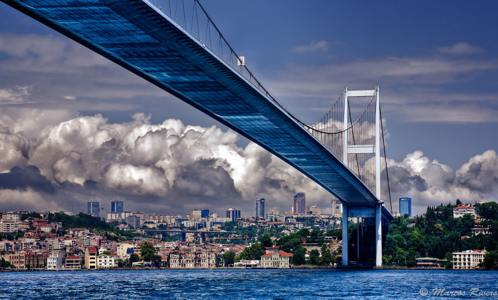 Photo in Architecture #turkey #istanbul #bridge #travel #tourism #water #bosphorus #strait #skyscrapers #city #houses #palace #muslim #arabic #mosque #hauling #sky #clouds