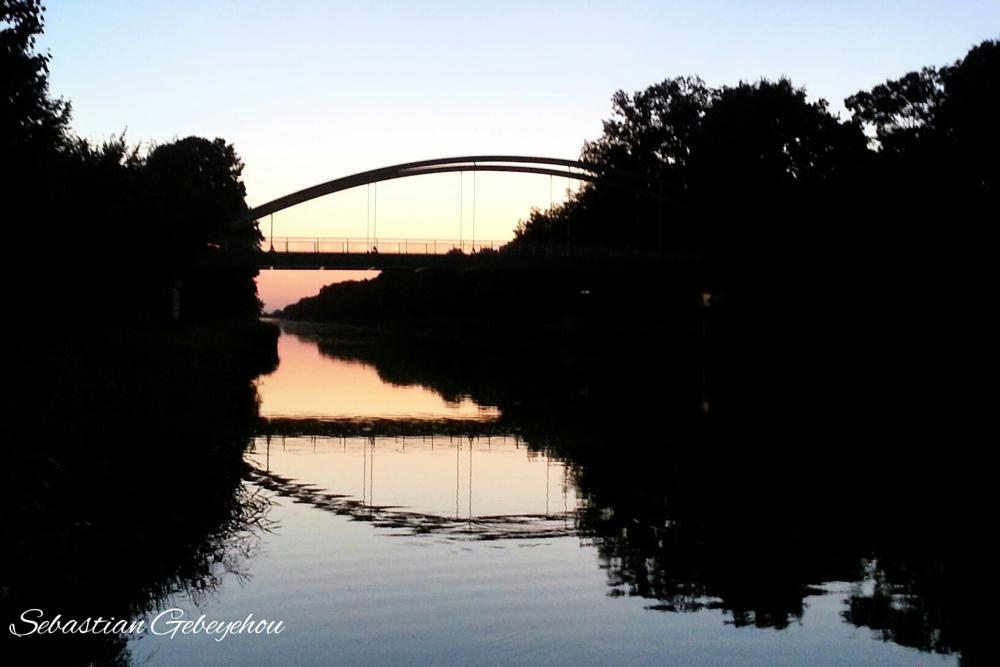 Photo in Cityscape #sonne #wasser #abendämmerung #sonnenuntergang #brücke