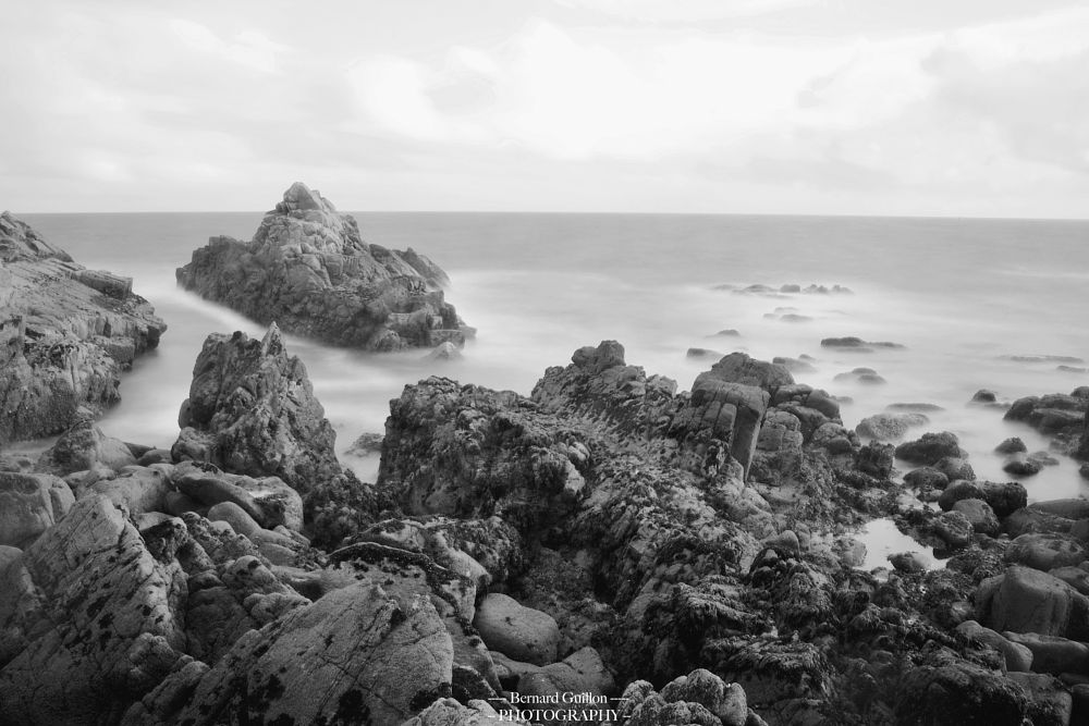 Photo in Sea and Sand #long exposure #black and white #nature #wild #coast #rocks #mist #sky #clouds #beautiful #wind #waves #sea