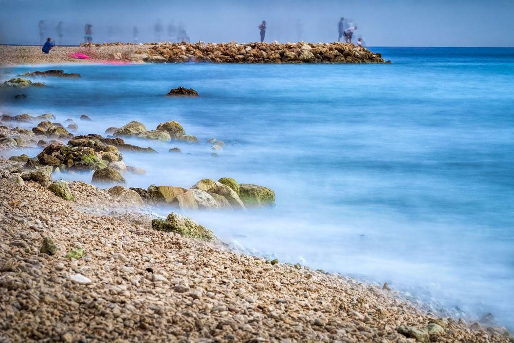 Photo in Sea and Sand #adriatic #sea #croatia.exposure #rocks #peebles #rock #rocky #beach #people #long #haze #water #waterscape