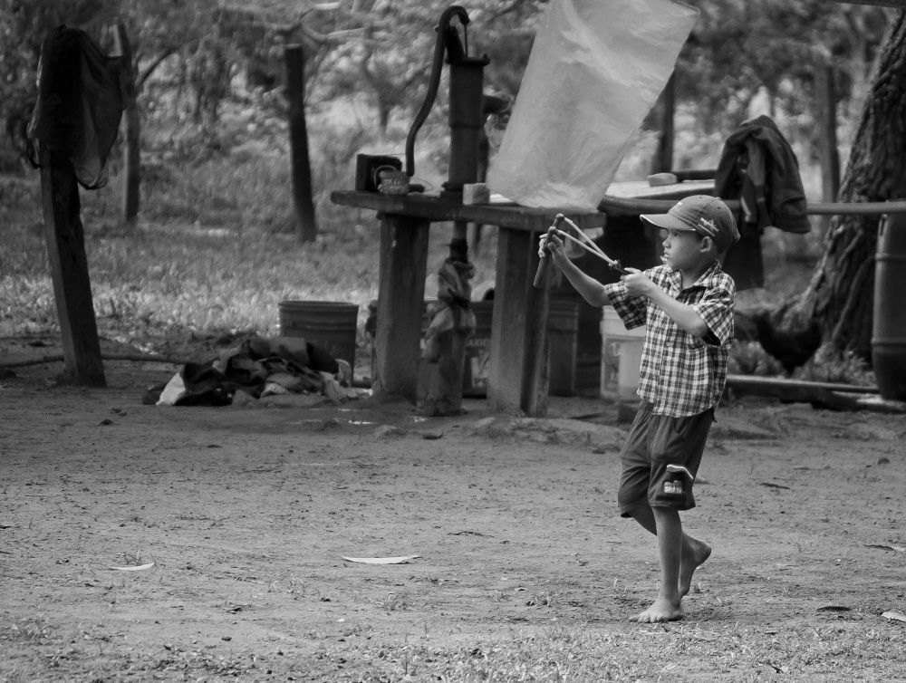 Photo in People #black and white #boy #catapult #child #depth of field #kid #los llanos #south america #venezuela