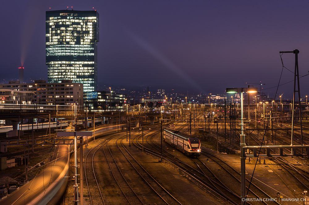 Photo in Cityscape #zürich #zurich #switzerland #swiss #suisse #schweiz #trains #train #sbb #sbb cff ffs #transport #prime tower #primetower #tower #building #architecture #city #cityscape #night #night photography #lights #motion #light in motion