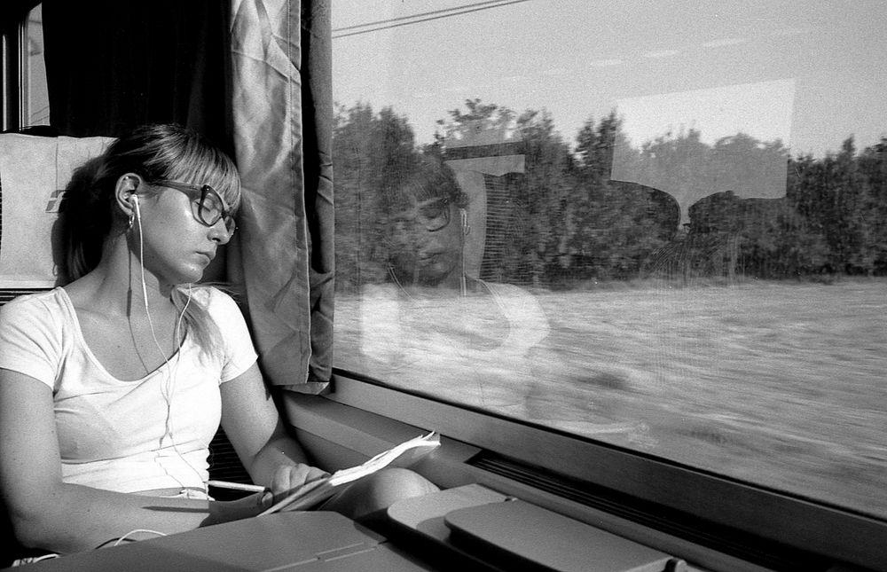 Photo in Street Photography #street #photo #leica #kodak #film #girl #train #student #reflection #sun #summer #window #beauty