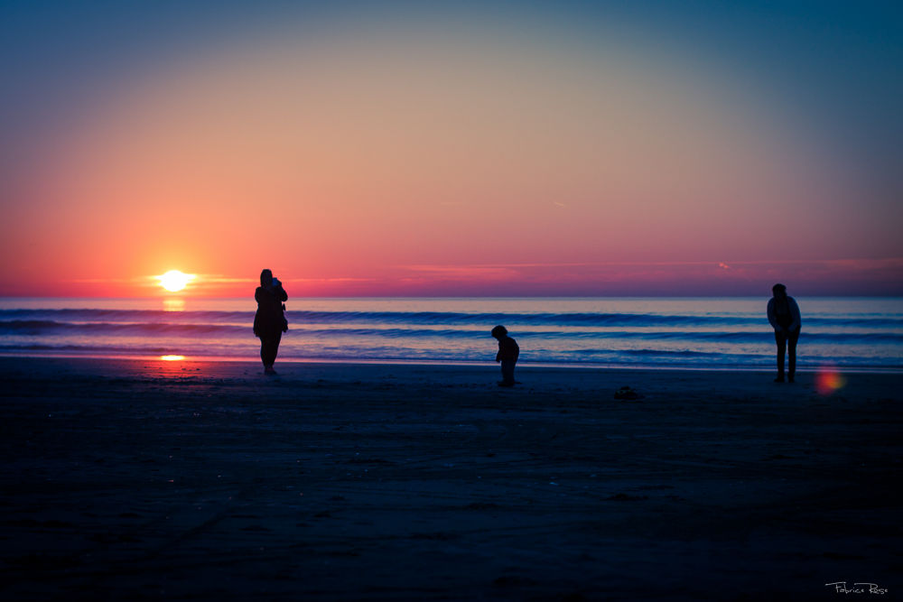 Photo in Family #sunset #family #deauville #beach #calvados #france #child #sea #seascape #silhouette #lens flare