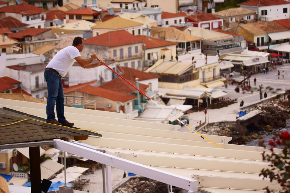Photo in People #preveza #summer #man #cleaning #restaurant #parga