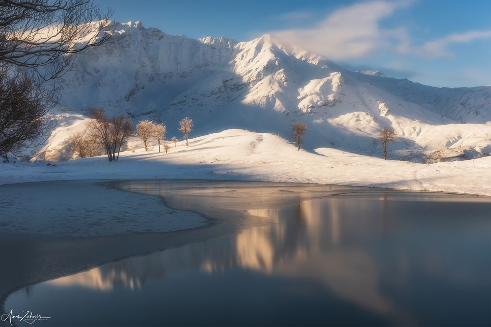 Photo in Landscape #frozen #lake #snow #winter #cold #water #sunrise #light #mountains #reflection #long exposure #sky #clouds #trees #iraq #kurdistan #choman #travel #landscape #nature #outdoor #photography #aws zuhair #the landscaper