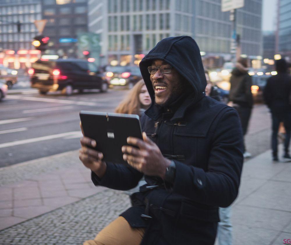 Photo in Street Photography #street #guy #tablet #photo #potsdamer platz