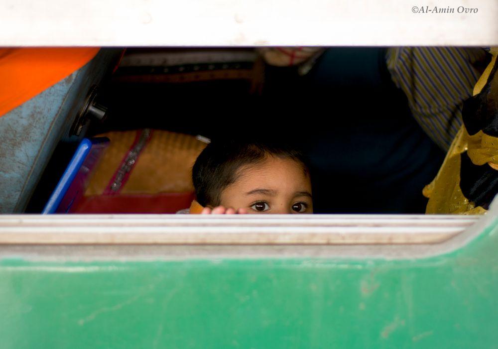 Photo in Street Photography #kid #baby #train #eyes #staring #train window