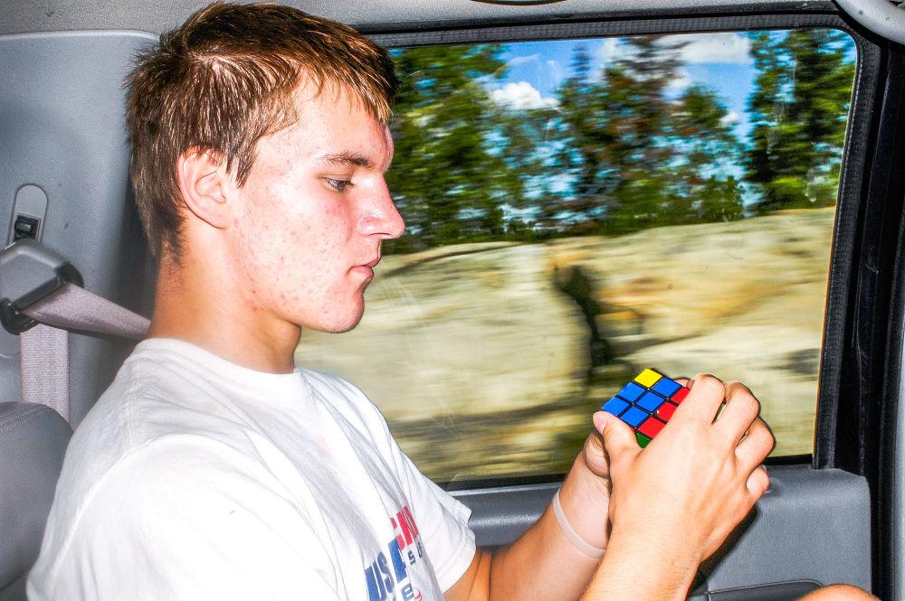 Photo in Portrait #rubik cube #canada #smart #summer #tree #movement