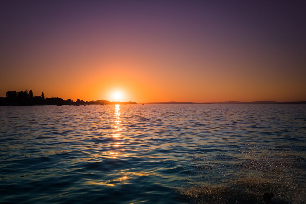 Photo in Landscape #sunset #dusk #sun #lake #sky #colorful #colors #summer #vibes #reflection #splash #fun #water #swimming #folks