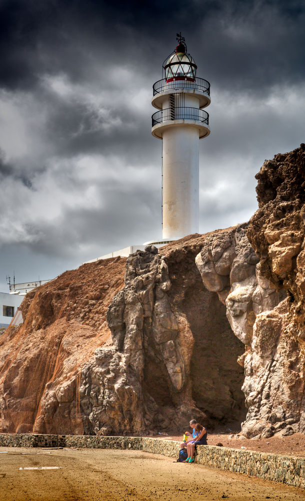 Photo in HDRI #ligthhouse #light #day #family #rocks #volcanic #clouds #sky #road #spain #gran canaria #taliarte #harbor #hdr