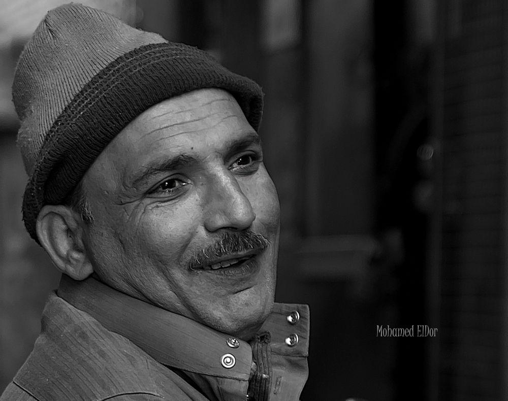 Photo in Random #smile #man #poor #simplicity #egypt #cairo #b&w #portrait #black and white