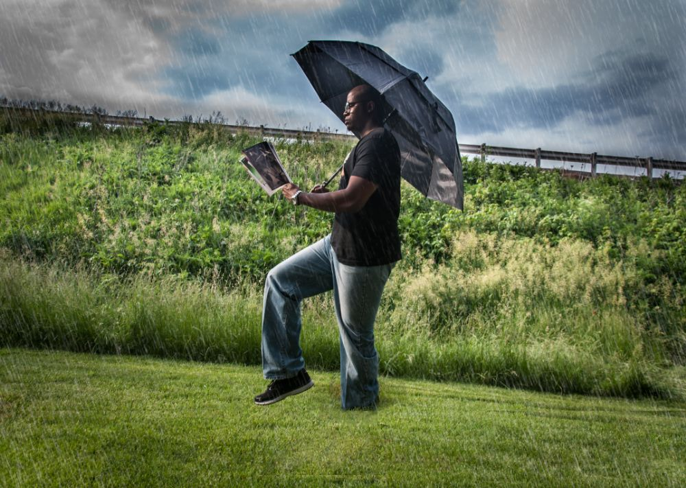 Photo in Portrait #stuck #walking #reading #photography #magazine #rain #stuck in grass #mud #ricardo williams #ricardo williams photography #umbrella