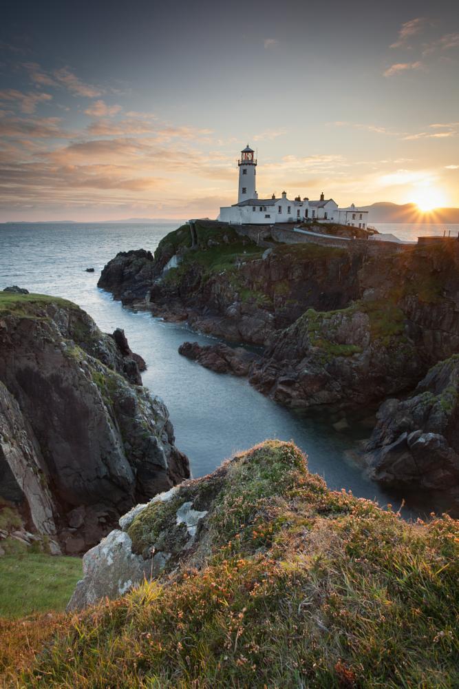 Photo in Landscape #sunburst #sunrise #seascape #ireland #donegal #fanad #lighthouse #coast