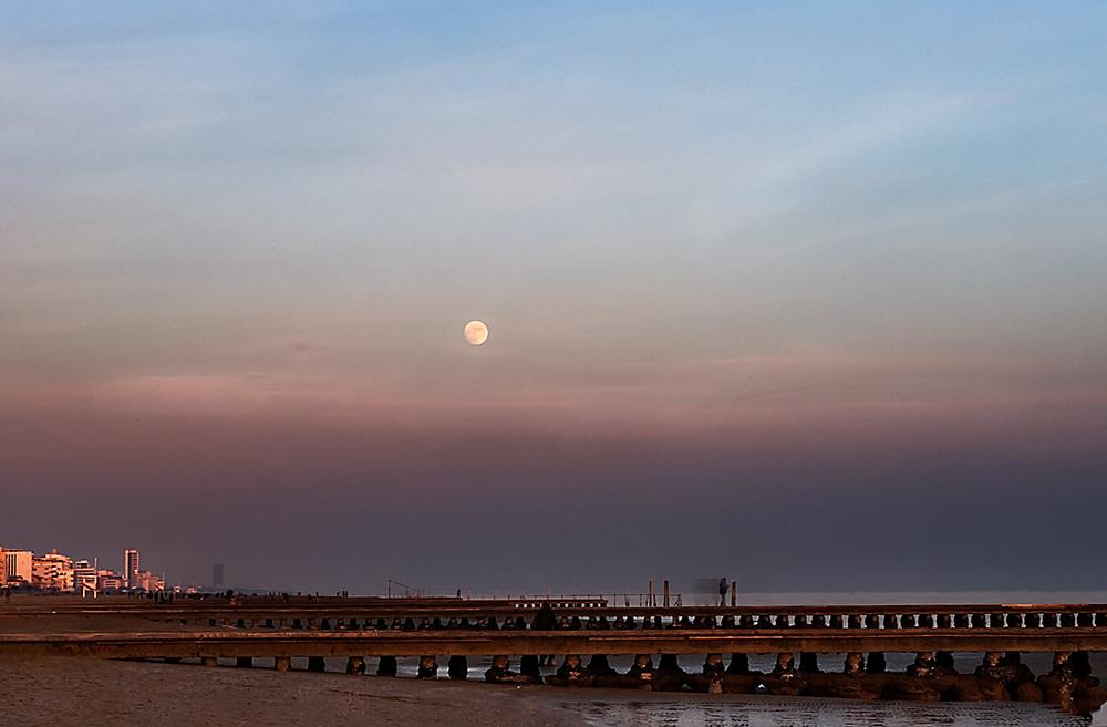 Photo in Cityscape #sky #colors #beach #sea #sunset