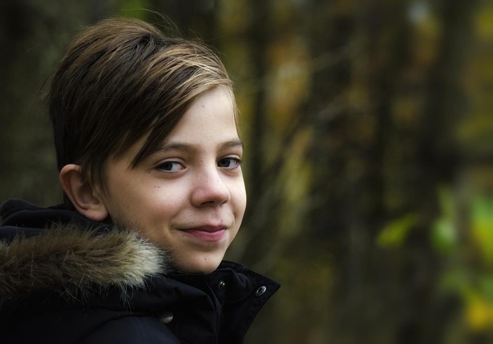 Photo in Portrait #boy #autumn #fur #eyes #smile #colour #color #alexander arntsen photography #photo #byarntsen