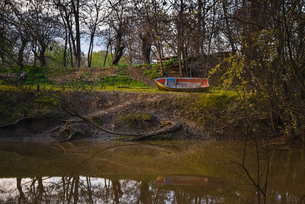Photo in Landscape #greece #river #boat #trees #water #reflection