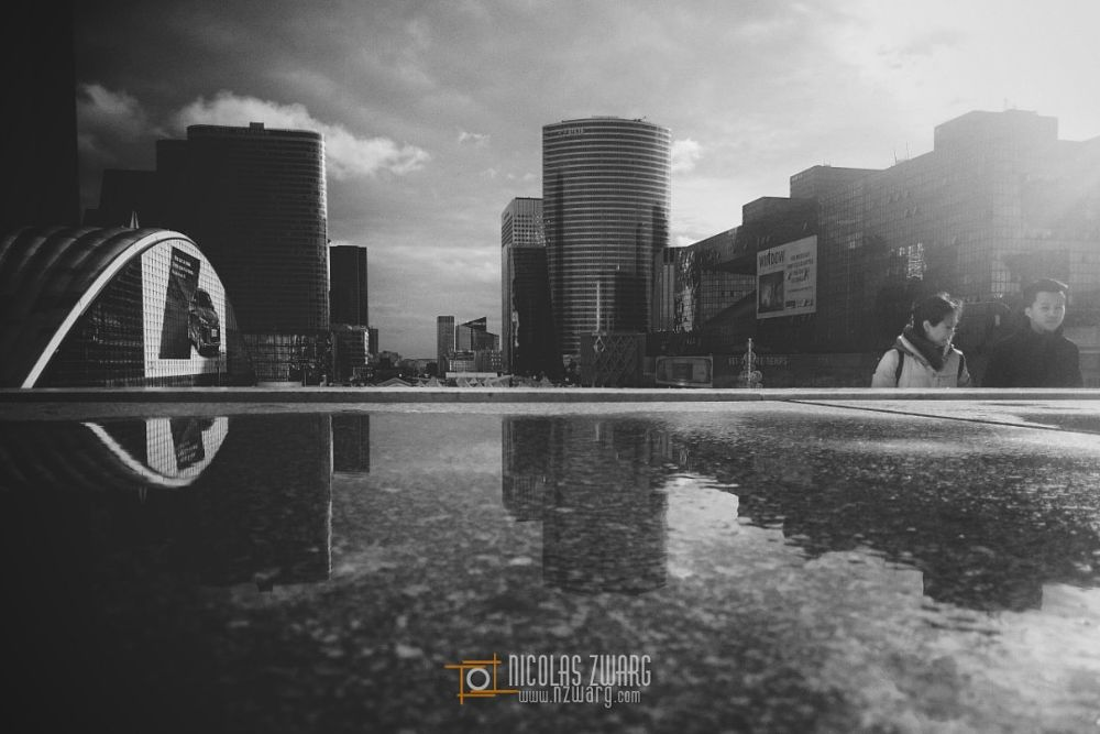 Photo in Street Photography #streetphotography #reflection #puddle #blackandwhite #b&w #paris #ladefense #cityscape #aftertherain