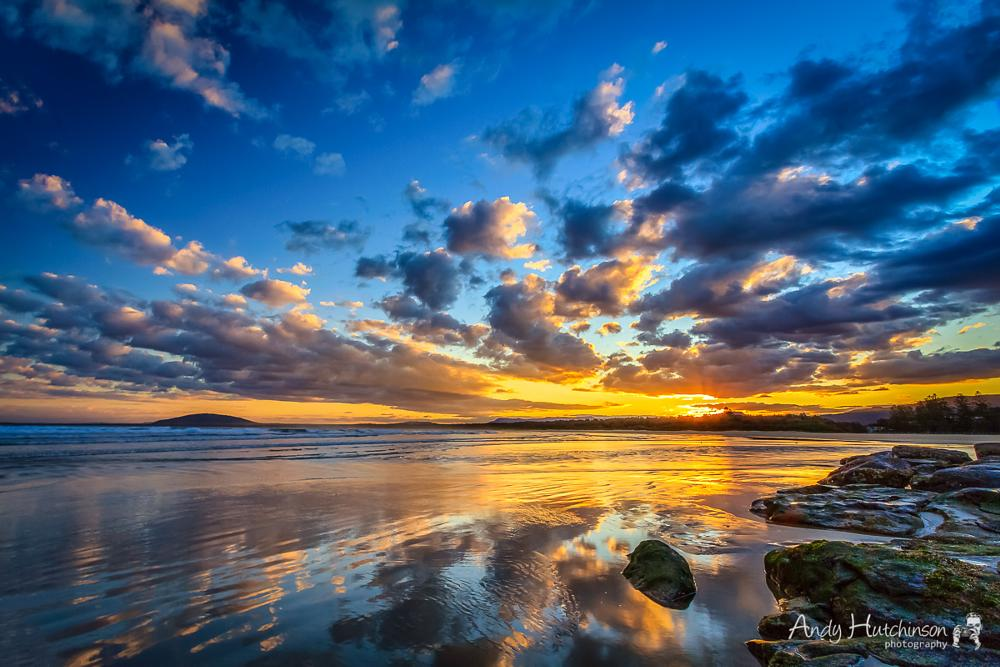 Photo in Sea and Sand #sunset #beach #rocks #clouds