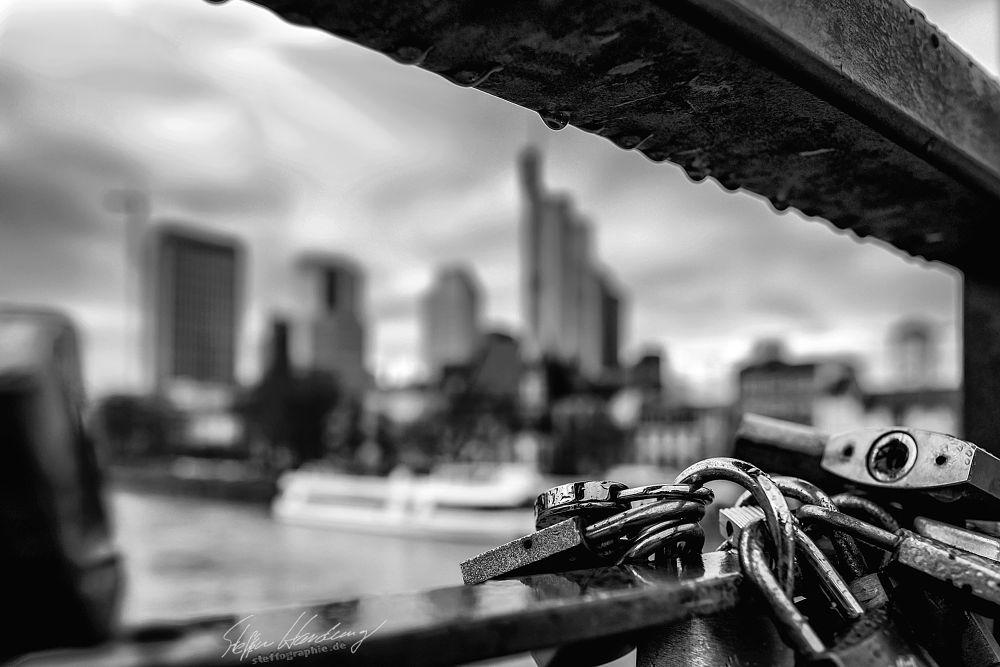 Photo in Black and White #skyline #frankfurt #city #blackandwhite #black & white #monochrome #steffographie #fuji #fujifilm #padlock #germany #through #main #river