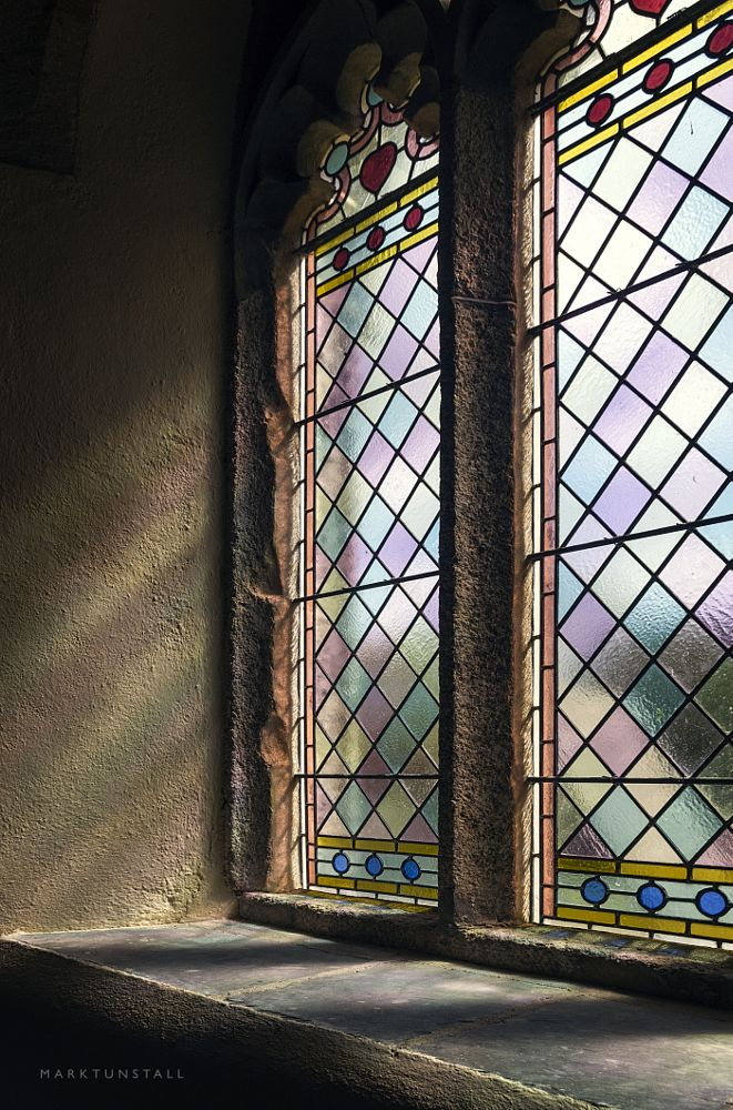 Photo in Architecture #light #stained glass #window #church #sunlight #rays #sunray #colours #coloured light #lead #leaded window #village #ancient #gothic #stone #stonework #pentax #architecture #interior #diamonds #shadows